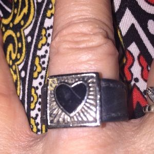 Black leather and silver heart cutout.  Size 7